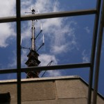 Broadcast equipment soars above the building.